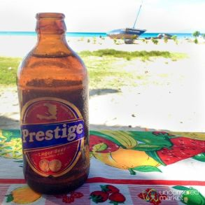A cold Prestige beer on the southern Hatian coast near Port Salut.